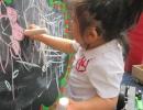 KS standing at chalk board Choice